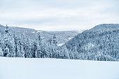Snowy landscape on the ski slopes in Bavaria in winter.