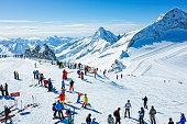 Skiers on top at winter ski resort Hintertux, Tirol, Austria.