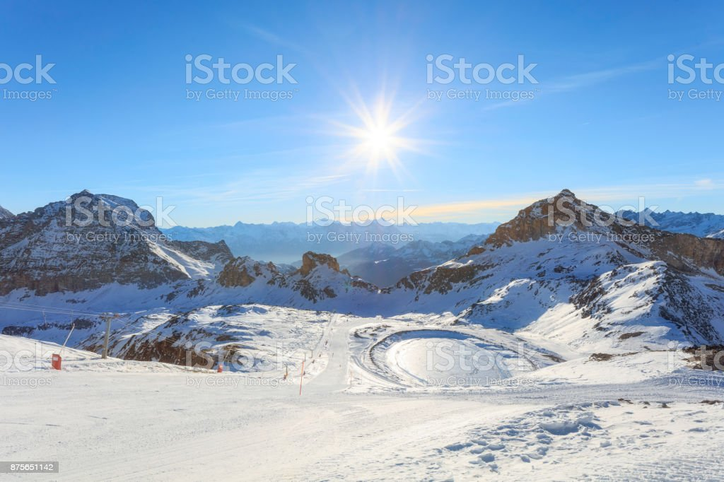 Panorama of Breuil Cervinia mountains in Alps. Ski lifts in winter