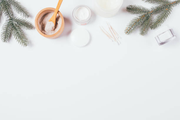 Winter skin care cosmetics and green fir branches stock photo
