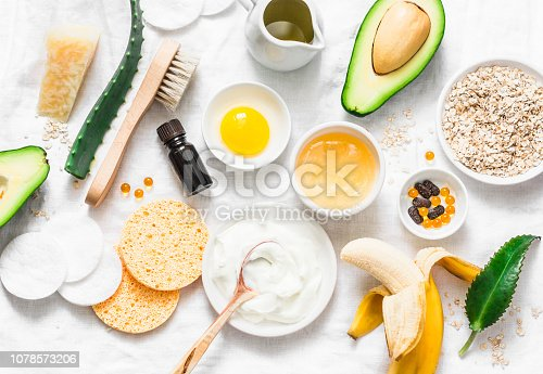istock Winter skin care. Homemade natural ingredients for a nourishing face mask on a light background, top view. Flat lay 1078573206