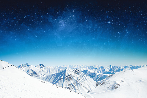 winter sky stars and the snow-capped mountains