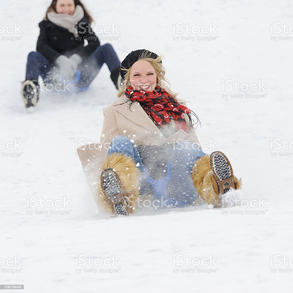 Winter Sled Fun - Luging down a hill royalty-free stock photo