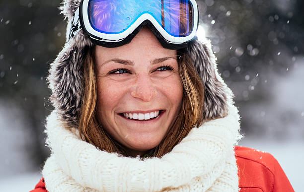 Winter smile Young woman smiling on snowy day ski goggles stock pictures, royalty-free photos & images