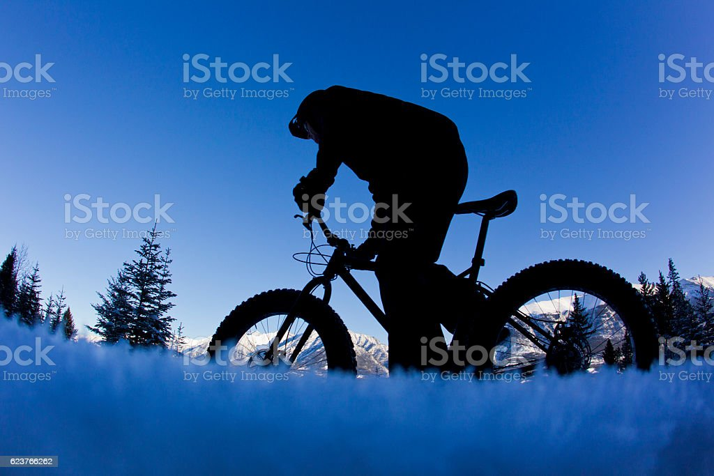 Winter Snow Bike Rider stock photo