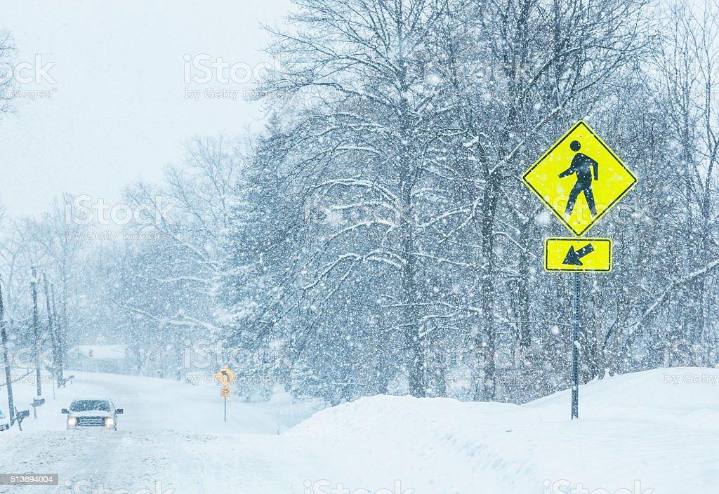 Winter Snow Blizzard Rural Road PEDESTRIAN CROSSING Road Sign stock photo