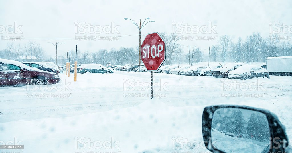 Winter Snow Blizzard Storm Full Car Parking Lot Stop Sign stock photo