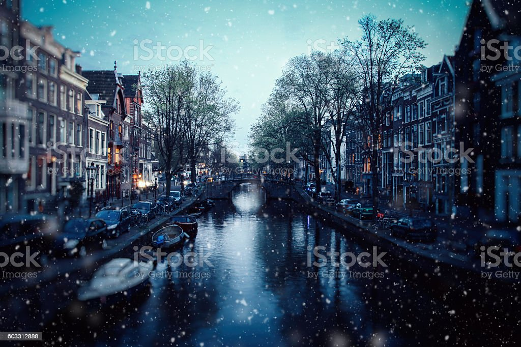 Winter snow christmas lights in Amsterdam, Netherlands stock photo