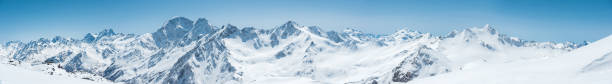 Winter snow covered mountain peaks in Caucasus. Great place for winter sports stock photo