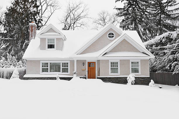 Winter Snow Craftman Cape Cod Style Home stock photo