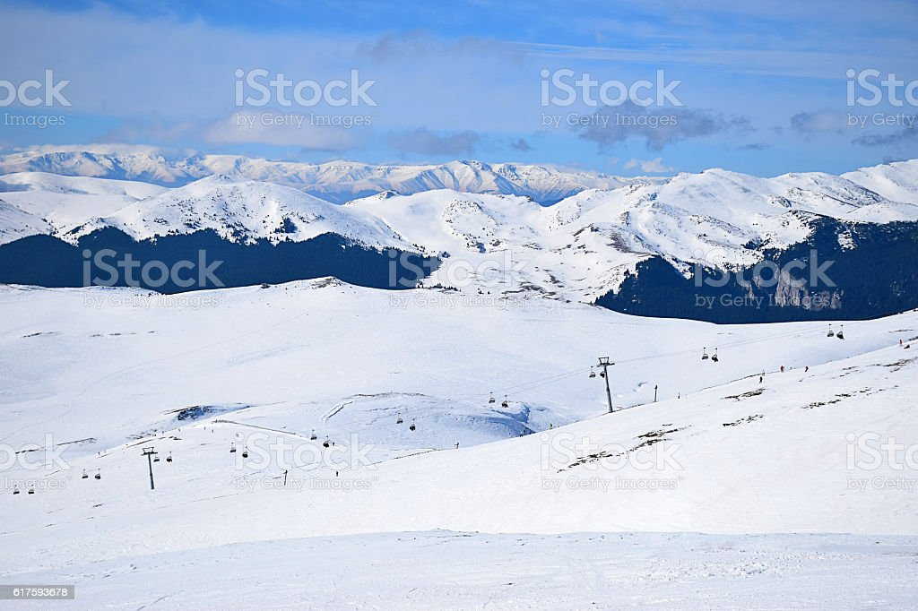 Winter snow landscape with ski pistes stock photo