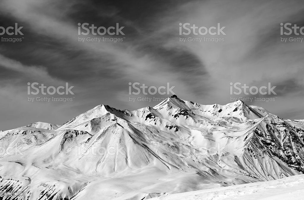 Winter snow mountains in windy day stock photo