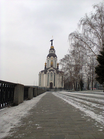 Winter Snow Orthodox Church on the Frozen Riverbank