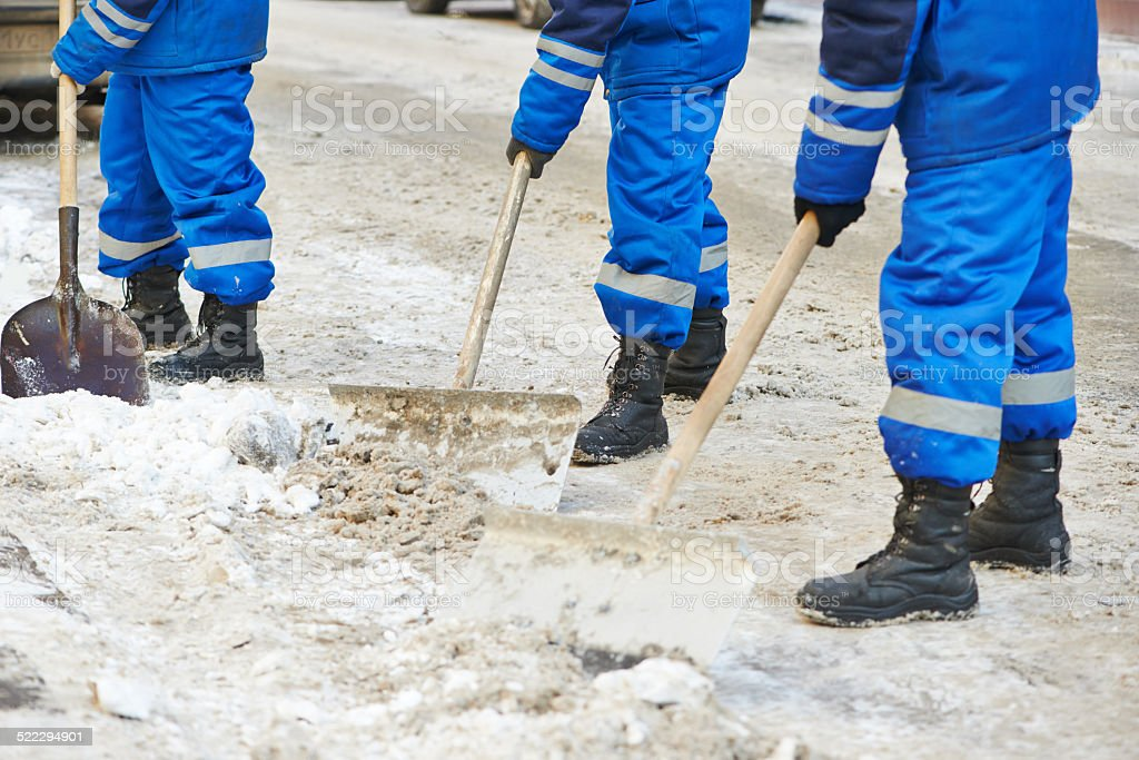 winter snow removal or city road cleaning stock photo