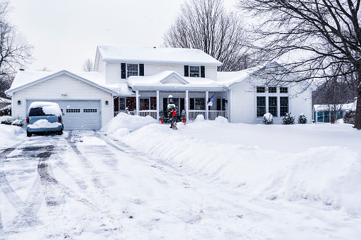 Winter Snow Storm Suburban Driveway And Home