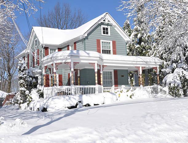 Winter Snow Suburban Large Home Sunny Day Blue Sky stock photo