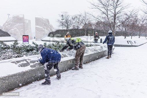 Washington Dc, United States - January 7, 2017: Winter snow storm with people playing by Martin Luther King Jr. Memorial