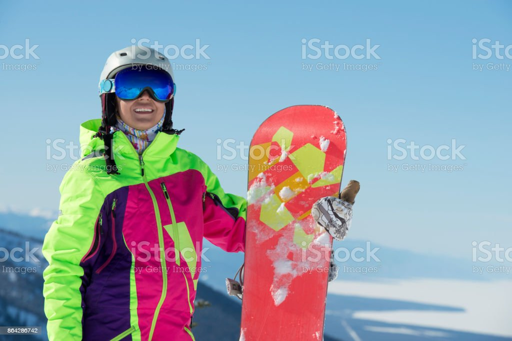 Winter snowboard travel destination. Portrait of snowboarder woman. royalty-free stock photo