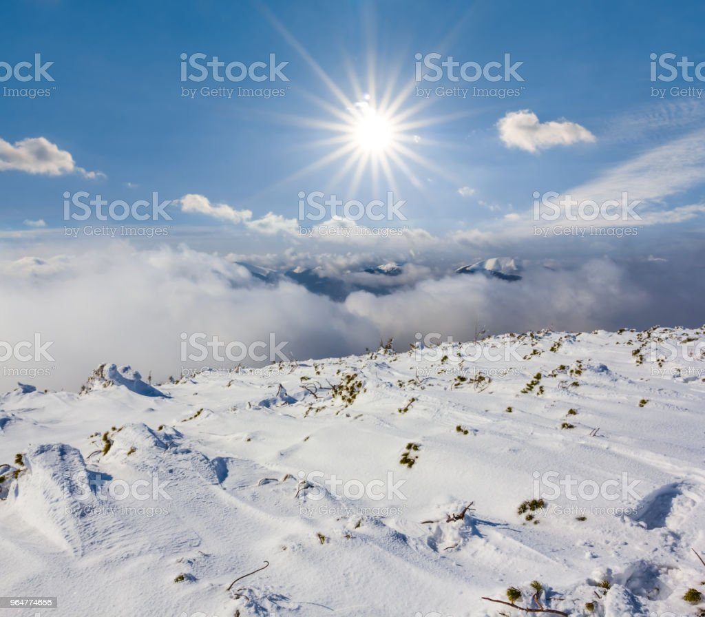 winter snowbound mountain under a sparkle sun royalty-free stock photo