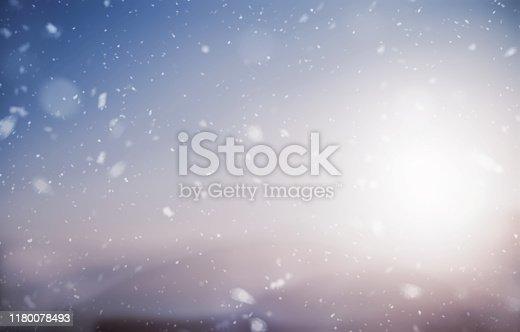 Snowfall over defocused landscape