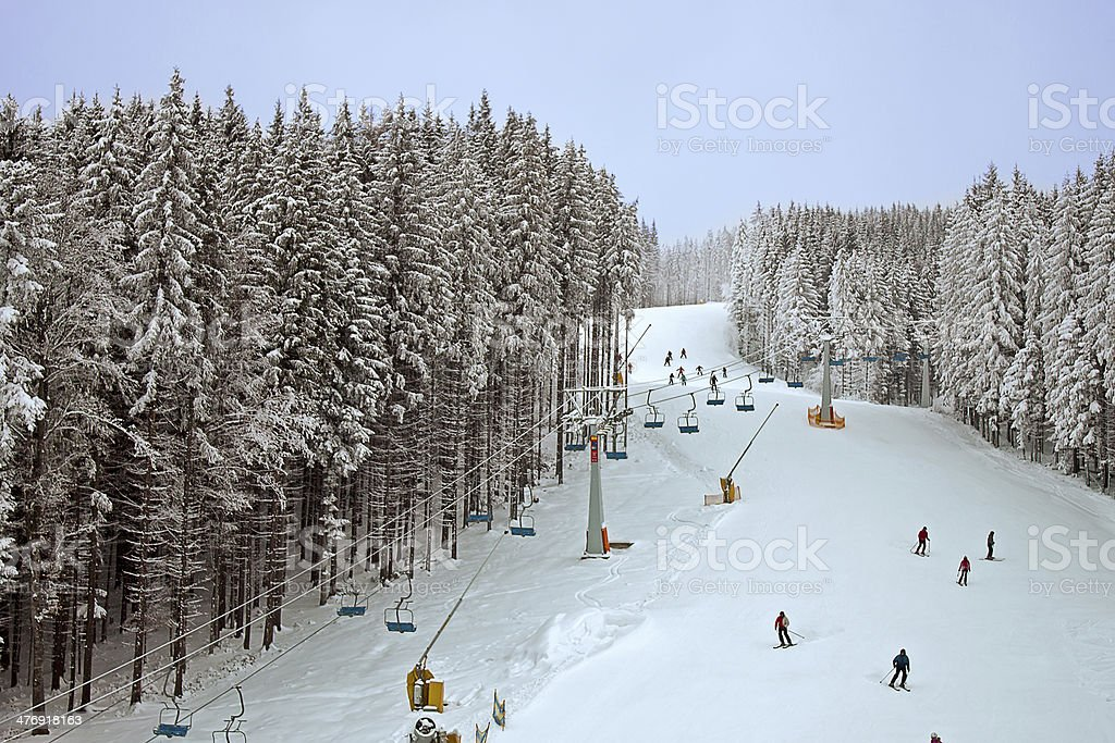 winter snowy forest and a chairlift for skiers stock photo