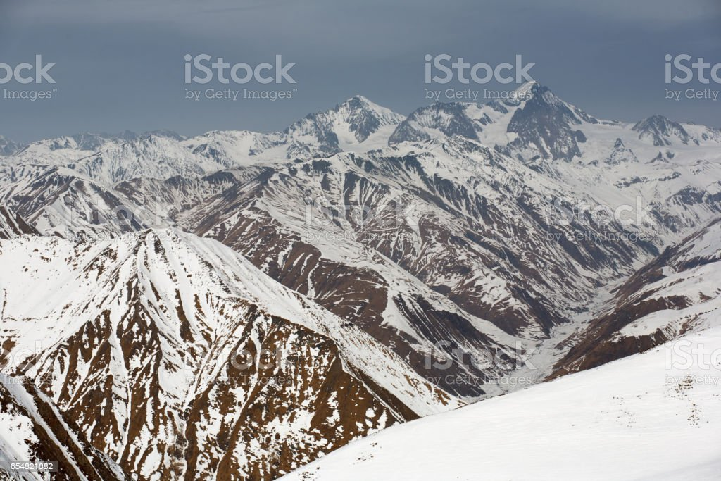 Winter Snowy Mountains And Blue Sky Caucasus Mountains