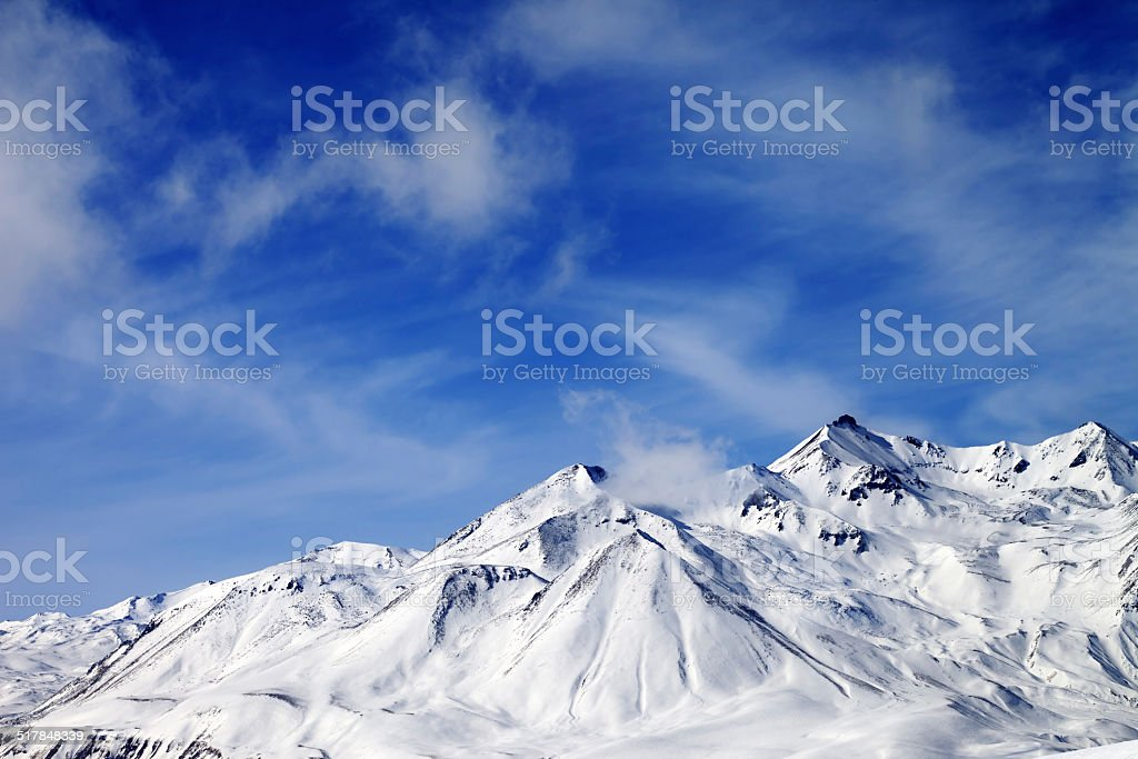 Winter snowy mountains at windy day stock photo