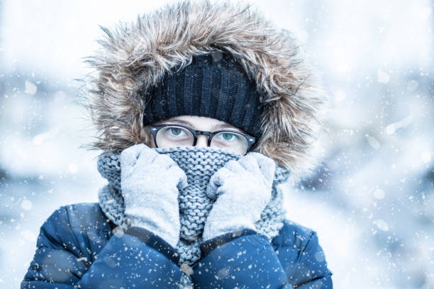Winter snowy portrait of young girl in warm clothing. Winter snowy portrait of young girl in warm clothing. warm clothing stock pictures, royalty-free photos & images