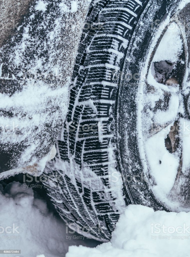 Winter snowy weather. Car stuck in the snow stock photo