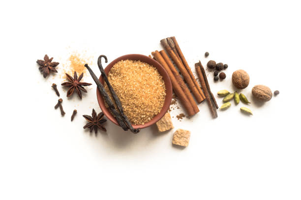 Winter Spices Winter Spices and Brown Sugar isolated on white background, top view, copy space. Mulled wine or Christmas seasonal baking ingredients - aroma spices. nutmeg stock pictures, royalty-free photos & images