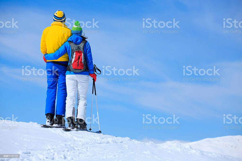 Winter sport   couple men and women snow skiers enjoying resting stock photo