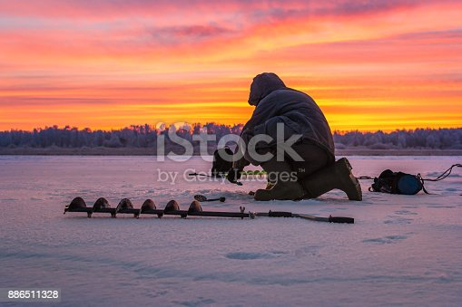 istock winter sport ice fishing 886511328