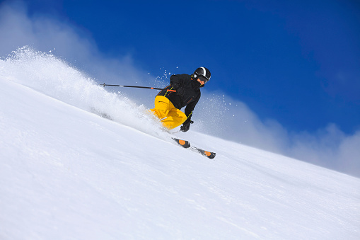 Winter sport  Senior men skier skiing on sunny ski resorts