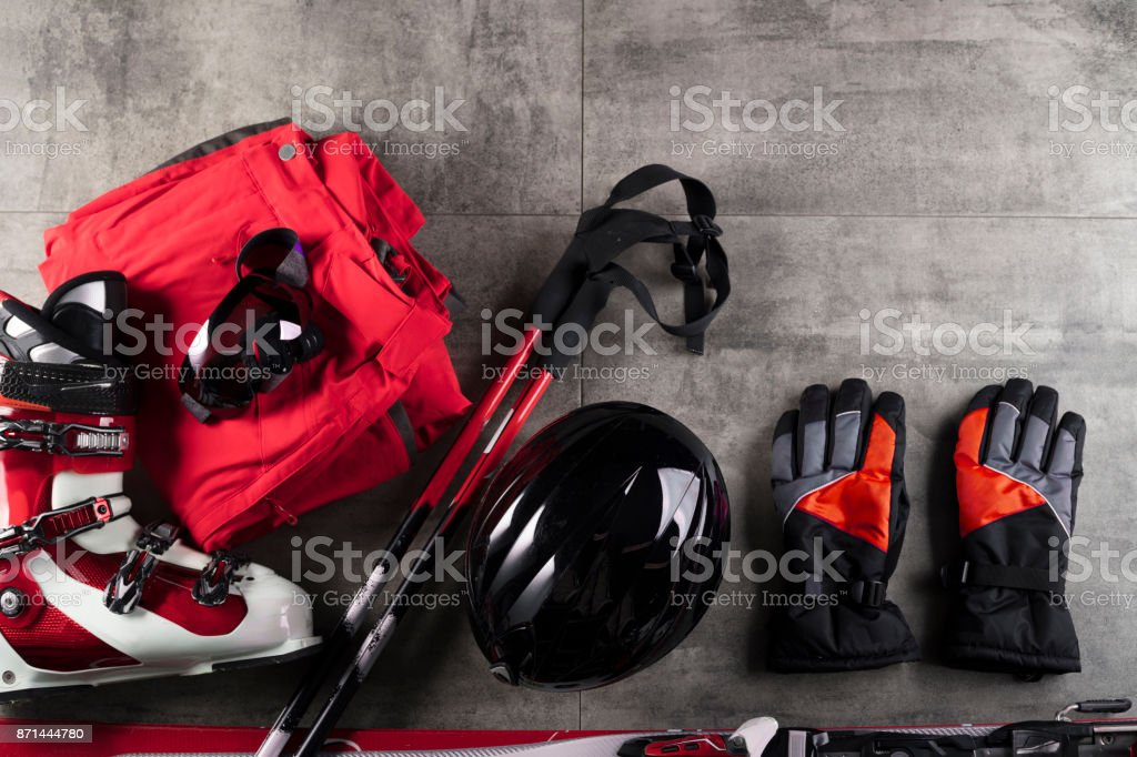 Winter sport theme. Ski equipment on gray tiles. Place for typography. Winter sport theme. Ski equipment on gray tiles. Place for typography. Activity Stock Photo