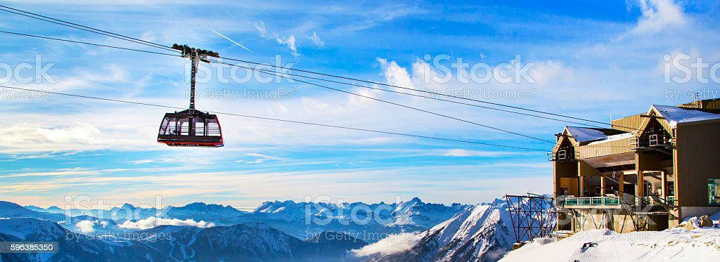 Winter sports travel background with cable car, mountain peaks stock photo