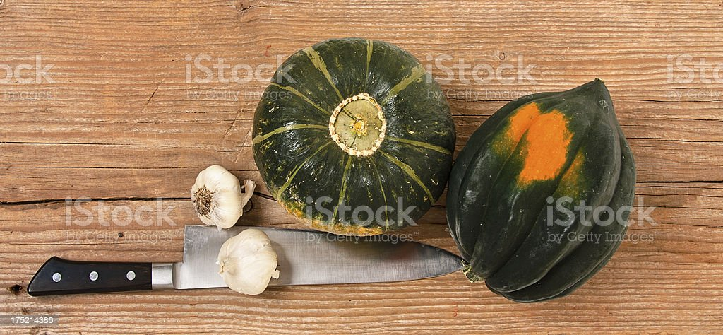 Winter Squash, Garlic and Kitchen Knife royalty-free stock photo