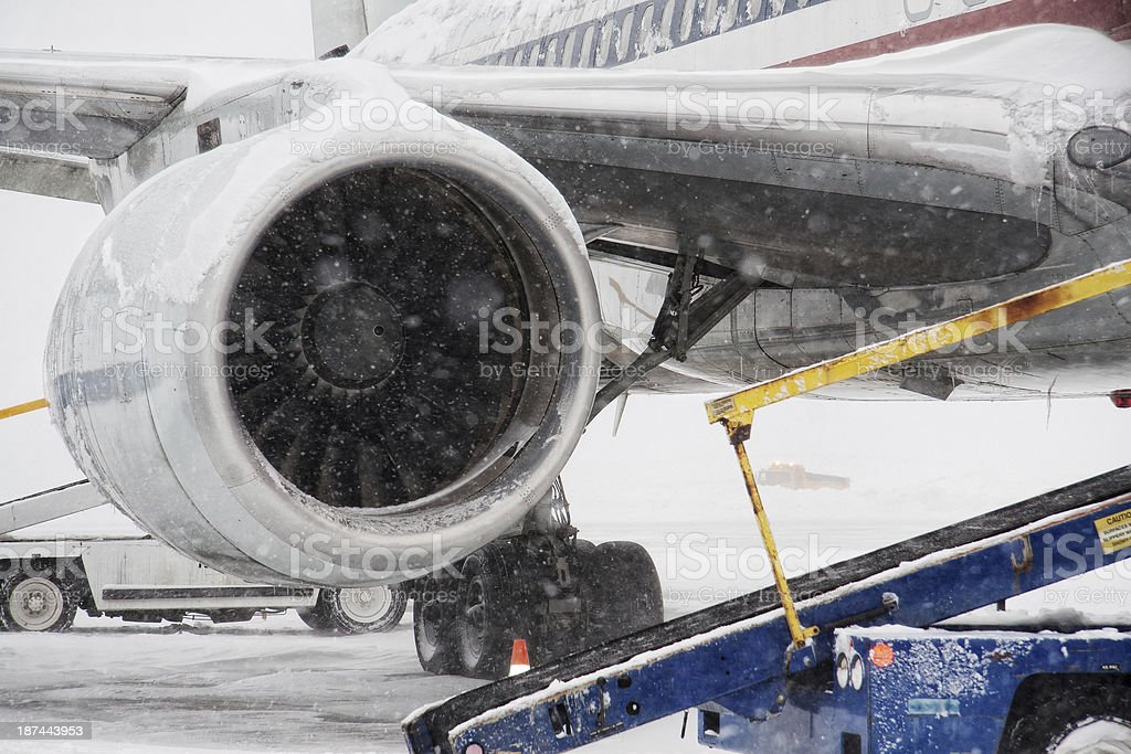 winter storm at airport stock photo