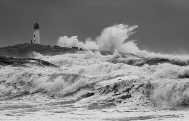 Winter Storm Grayson Heavy seas associated with 'Winter Storm Grayson' also known as the 'Bomb Cyclone' washes against Peggy's Cove Lighthouse. beacon stock pictures, royalty-free photos & images