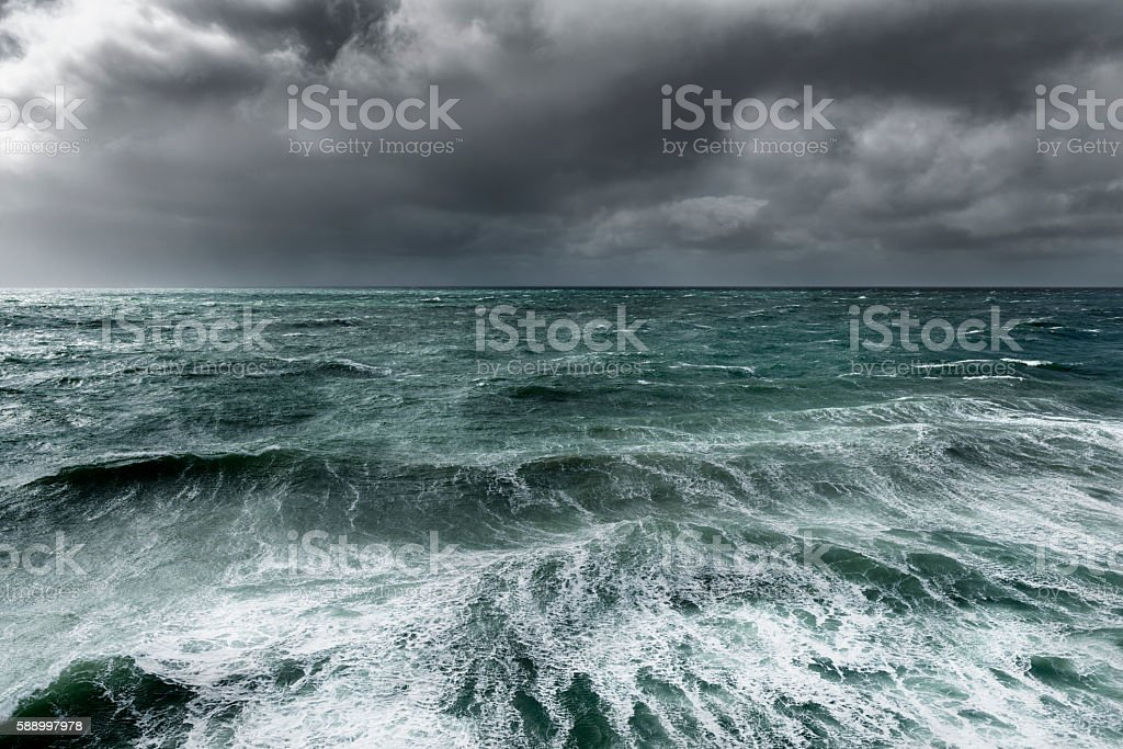 Winter storm over ocean with rough seas stock photo
