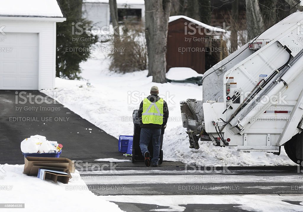 Winter Suburban Garbage and Trash Collection stock photo