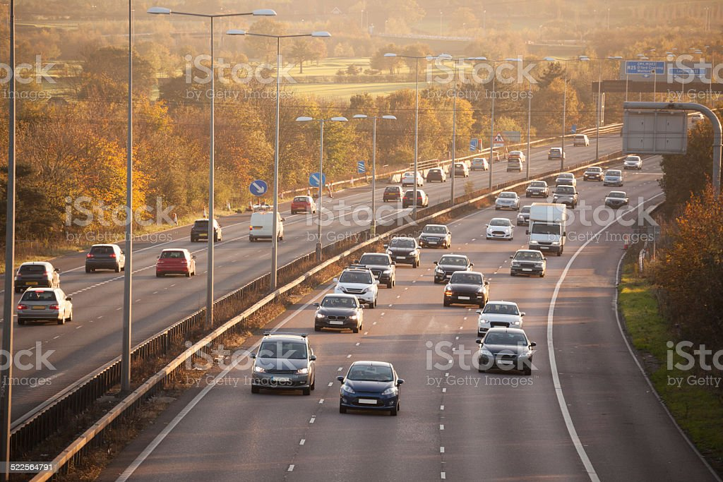 winter sun on sunday motorway traffic Essex England stock photo
