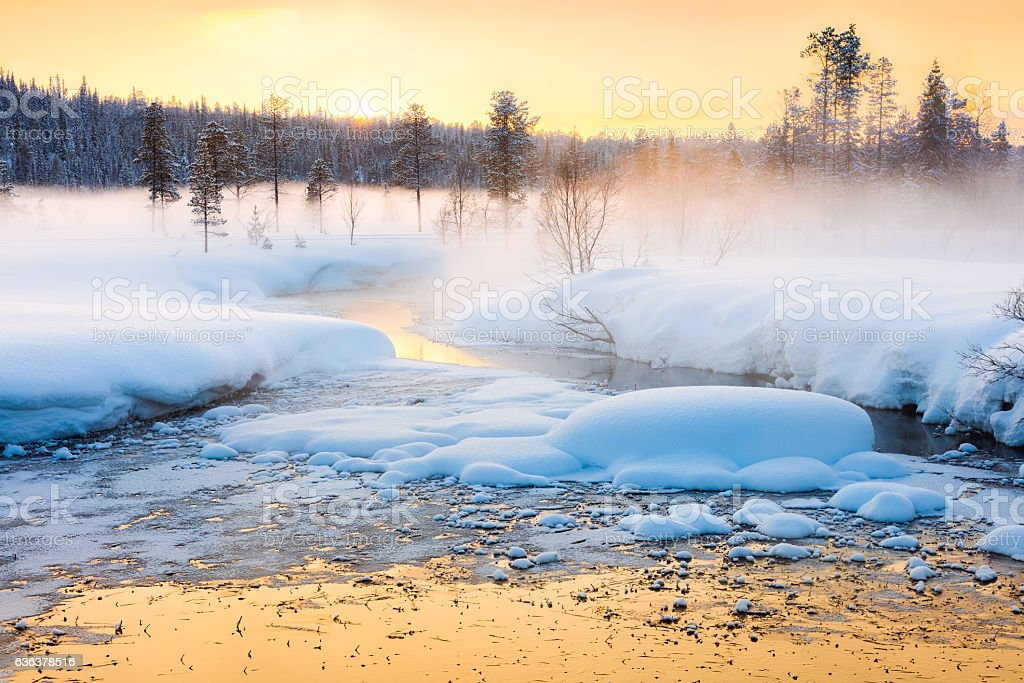 Winter sundown in forest and river with beautiful misty fog stock photo
