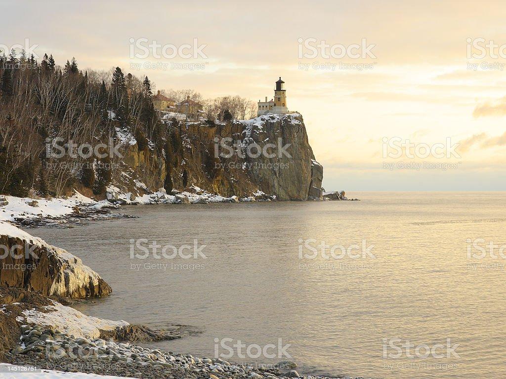 Winter sunrise on lake superior near splitrock lighthouse stock photo
