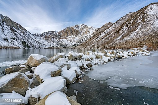 the sun is rising at Convict Lake on a cold Winter morning high up in the Eastern Sierra,California