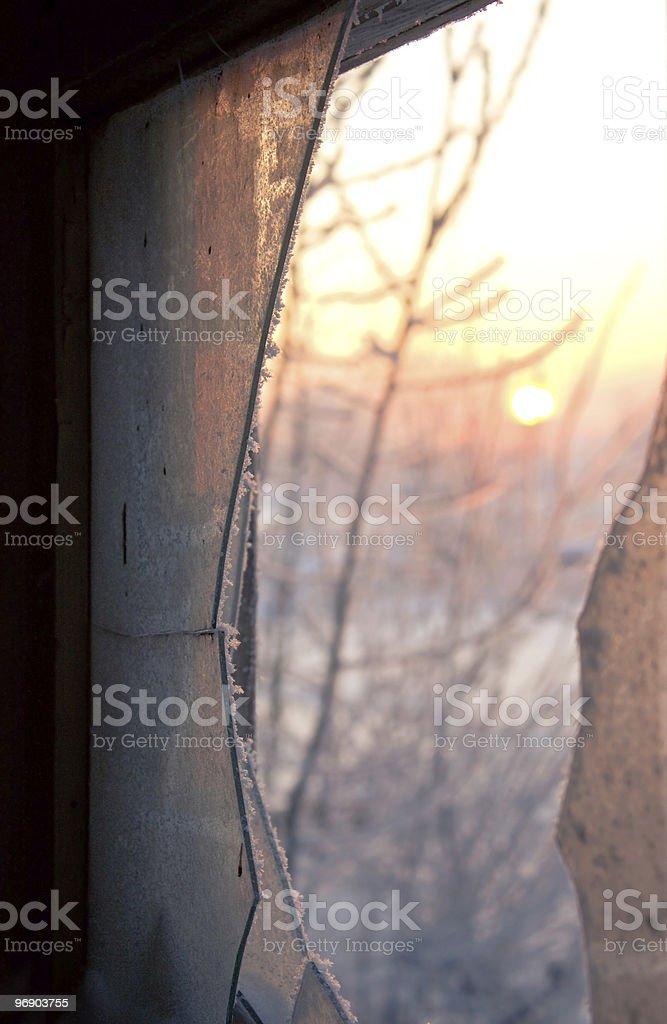 Winter sunset on broken window royalty-free stock photo
