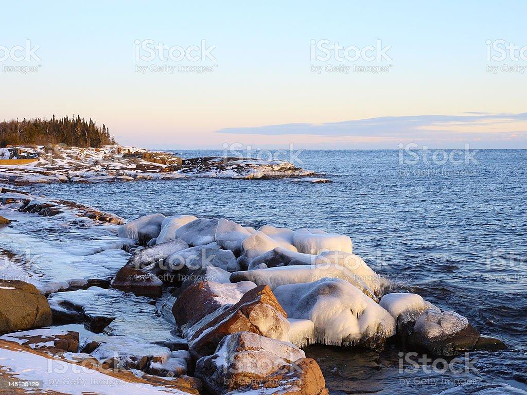 winter sunset on lake superior stock photo