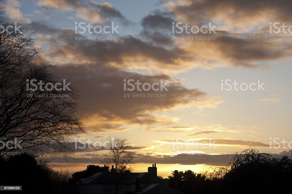 Winter sunset over a silhouetted skyline royalty-free stock photo