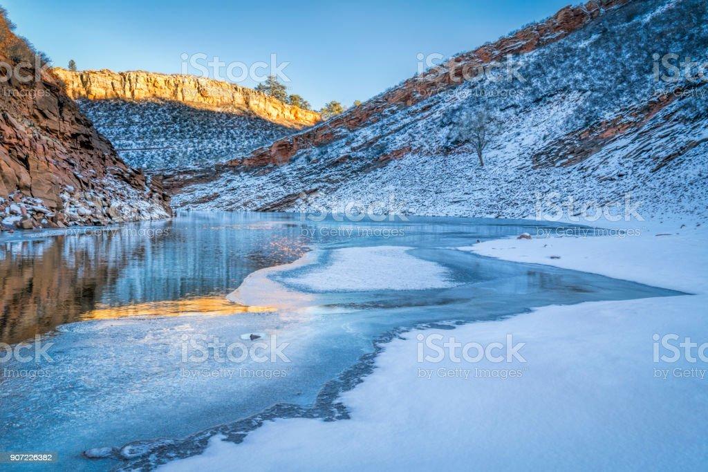 winter sunset over mountain lake stock photo