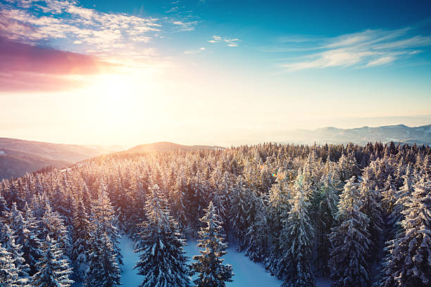winter sunset - snowy mountains stock photos and pictures