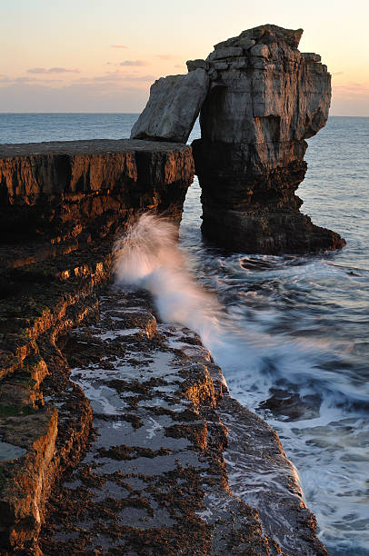 Winter sunset Pulpit Rock on Portland Dorset. stock photo
